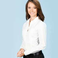 Portrait of smiling businesswoman, over blue