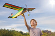 Teen with homemade radio-controlled model aircraft