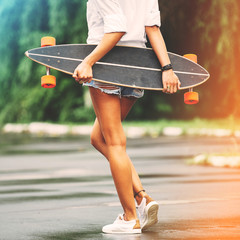 Fashion lifestyle, beautiful young woman with longboard. Lightle