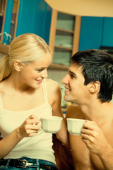 Couple drinking coffee together at home