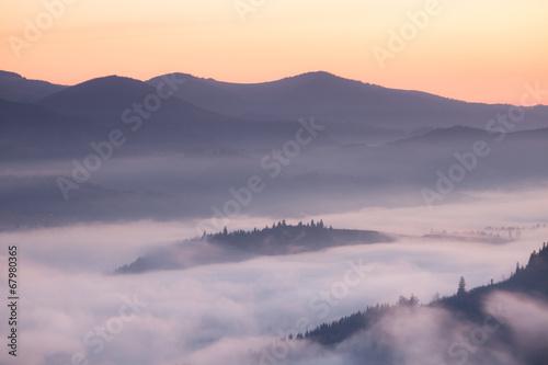 Mountains ridge at foggy morning