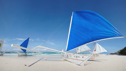 Blue sail against blue sky a