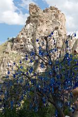 Evil eye in tree behind Uchisar Castle in Cappadocia,