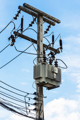 Electric post with sky background