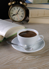 hour to drink a cup of coffee at a table in the library
