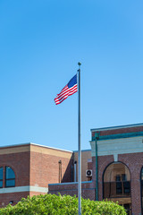 American Flag in Front of Old Brick Building