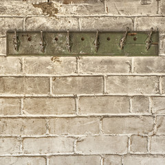 rack on the weathered brick wall