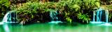 Fototapety Panorama of waterfall in garden design.