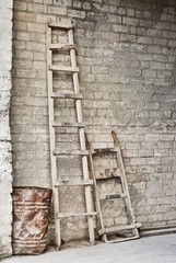 grunge wall, ladder, old barrel, vintage wheelbarrow