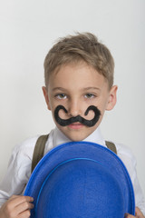 Boy with artificial mustache
