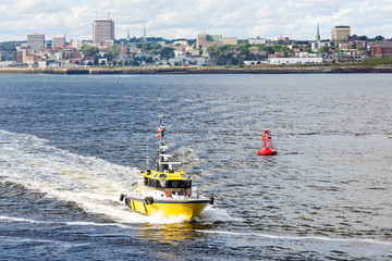 Yellow Pilot Boat and Red Channel Marker