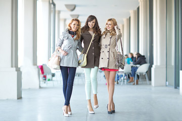 Three cheerful woman walking in the first day of spring