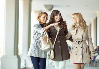 Group of gladsome women laughing together