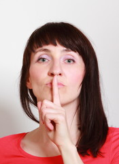 Woman showing hand silence sign