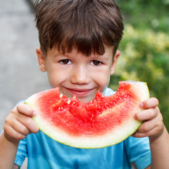 Little cute caucasian boy holding melon