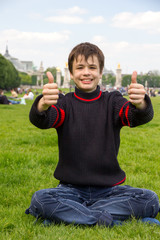 Cheerful teenager shows thumb up on the Esplanade des Invalides