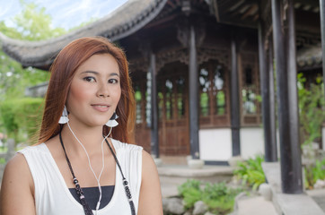 Smiling young woman enjoying her music