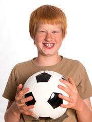 happy red haired boy with football