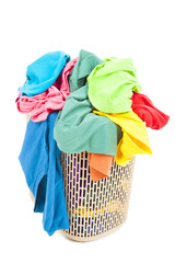 a pile of colorful and mess clothes in the basket