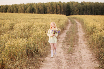 girl with flowers at field