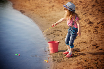 child playing in fishing