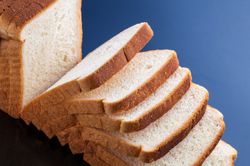 slices of bread on blue background
