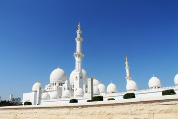 The Abu Dhabi Mosque on the blue background