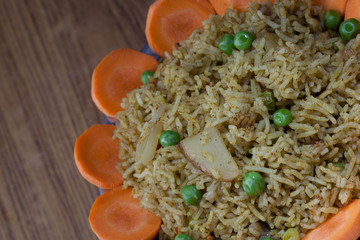 A healthy tomato  biriyani with a salad of carrot