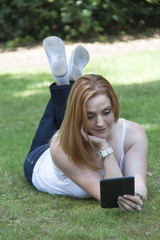 Redhead girl with ereader