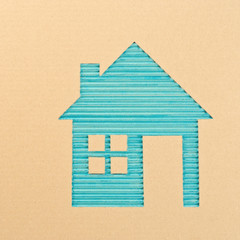 House cut out on a corrugated cardboard