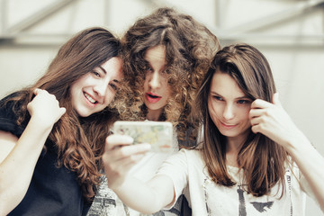 three funny pretty girls make self photo