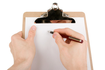 Hand writing on empty document in a clipboard