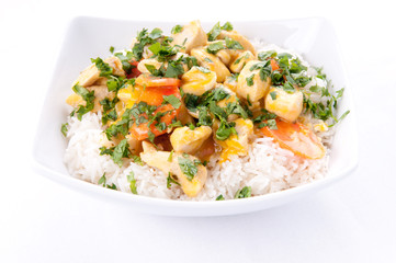 Thai coconut and mango curry with diced chicken and sliced carro