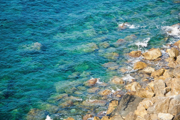 Rocky coast with clean blue see-through water. Cinque Terre Ital