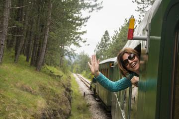 Pretty young woman boarding a train
