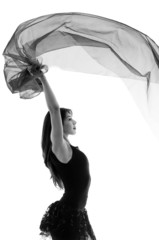 Young beautiful ballerina dancing with a flying veil