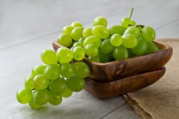 Bunch of grapes in a wooden bowl