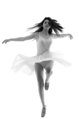 Graceful ballerina dancing en pointe