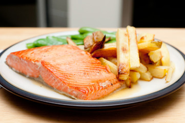 maple glazed salmon fillet with french fries and snap peas, full