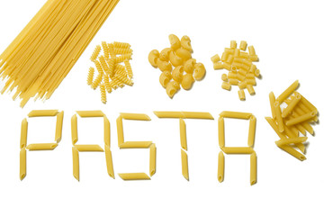 Various types of pasta in piles and shaped in letters isolated