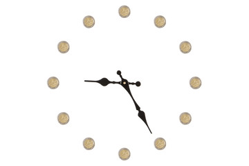 Clock made out of euro coins isolated on a white background