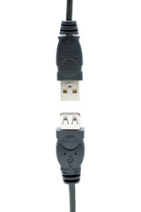 Two USB plugs almost connected isolated on a white background