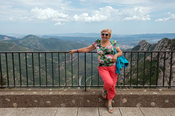 Aged woman on  Llobregat valley background, Montserrat, Cataloni