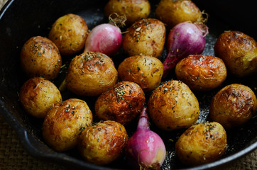 Homemade whole baked young potato and violet onion