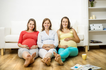 Pregnant women on sofa