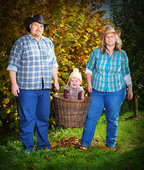 Farmer's family in their orchard.