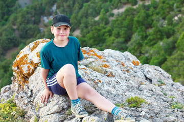 boy on a mountain top