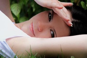 Beautifull woman is lying and resting in the grass