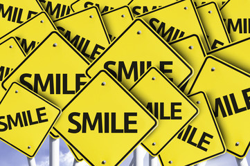 Smile written on multiple road sign