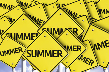 Summer written on multiple road sign
